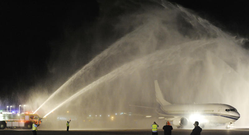 A plane carrying the Stanley Cup winning Chicago Blackhawks is welcomed with water cannons after arriving at O'Hare International Airport in Chicago, on Tuesday, June 25, 2013. (AP Photo/Paul Beaty)