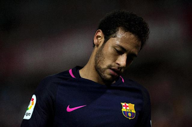Barcelona's Neymar was shown the first red card of his Barcelona career for two bookable offences in defeat at Malaga (AFP Photo/JORGE GUERRERO)