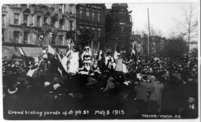 In this photo provided by the Library of Congress, taken in 1913, the woman's suffrage procession in Washington being stopped by a crowd. Thousands of women take to the streets of Washington, demanding a greater voice for women in American political life as a new president takes power. This will happen on Saturday, Jan. 21, 2017, one day after the inauguration of Donald Trump. This DID happen more than 100 years ago, one day before the inauguration of Woodrow Wilson. (Library of Congress via AP)