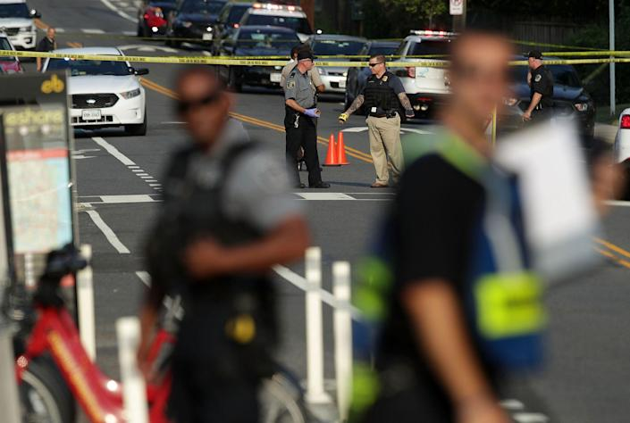 <p>Investigators gather near the scene of an opened fire June 14, 2017 in Alexandria, Virginia. Multiple injuries were reported from the instance. (Photo: Alex Wong/Getty Images) </p>