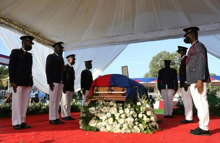 The coffin of Haiti's slain leader Jovenel Moise is draped in the national flag as his funeral begins