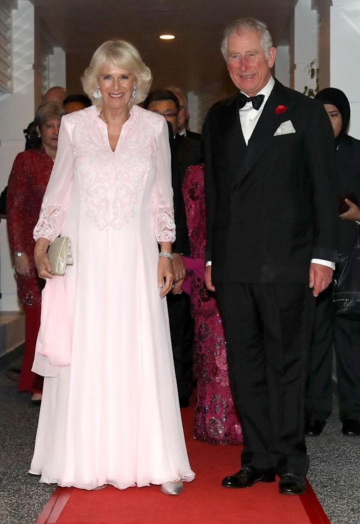 <p>Camilla wore this long, embroidered pink gown and diamond earrings for a gala dinner with the Prime Minister of Malaysia in Kuala Lumpur.</p>