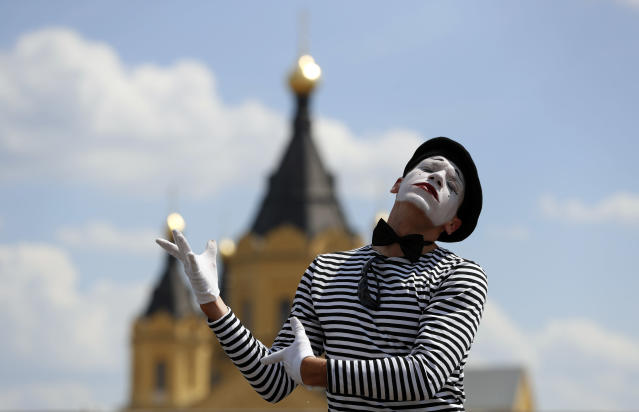 A street artist performs outside the venue ahead of the group G match between England and Panama at the 2018 soccer World Cup at the Nizhny Novgorod Stadium in Nizhny Novgorod , Russia, Sunday, June 24, 2018. (AP Photo/Darko Bandic)