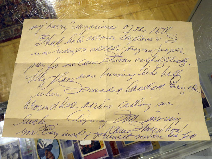 A photo shows part of a letter by Boston Red Sox slugger Ted Williams the day after he crash-landed his airplane during the Korean War. (AP)