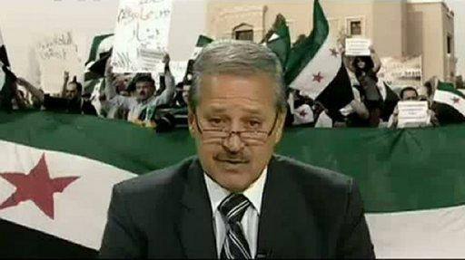 Syrian Ambassador to Iraq Nawaf Fares, seen here reading a statement on July 11, in which he announced his defection to the Syrian opposition, in video shown on YouTube on July 12. Pressure mounted on Syrian President Bashar al-Assad on Thursday after Fares became the first senior diplomat to defect and Western powers drew up a 10-day sanctions ultimatum