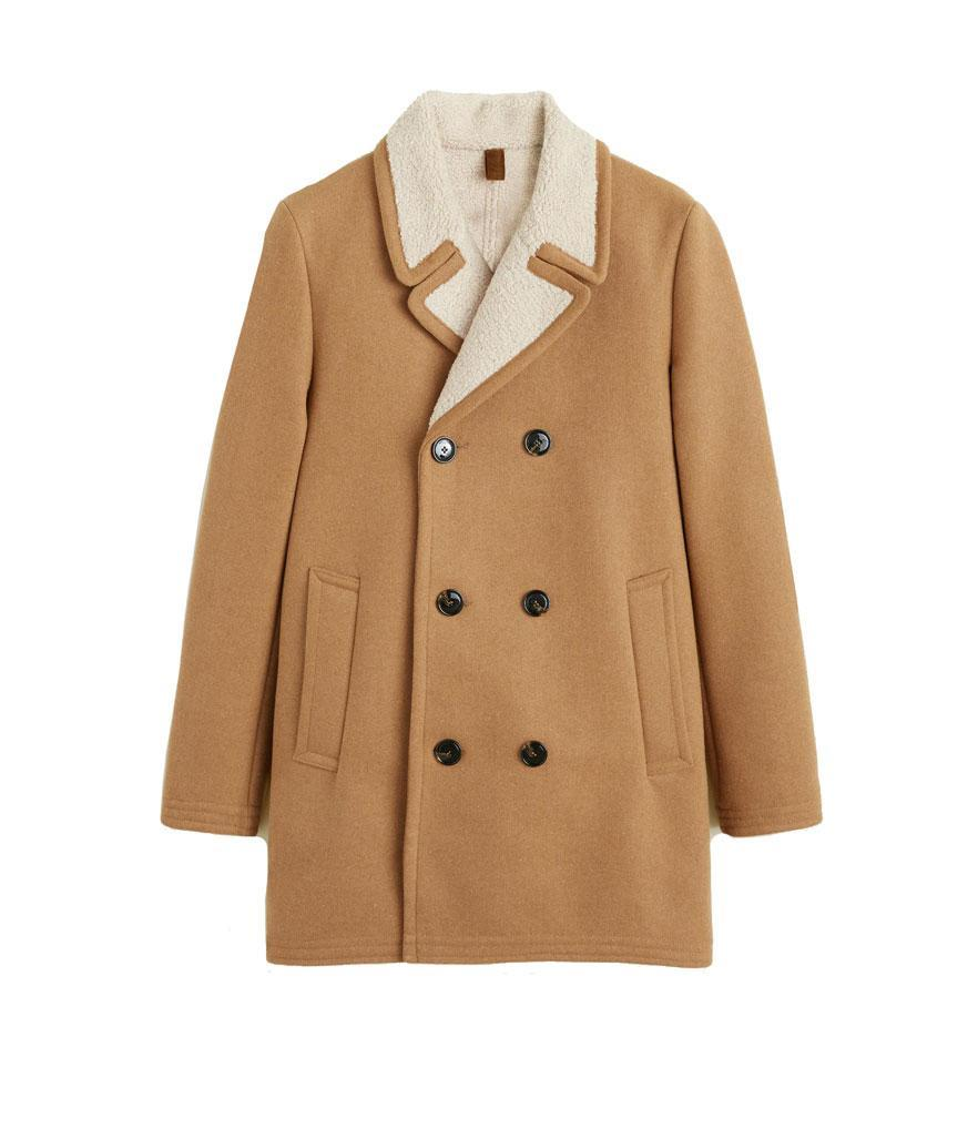 "<p>This double-breasted camel coat has a faux shearling collar, which gives it an elevated feel without a hefty price point. <br>Shop it: Mango Faux Shearling-Lined Lapel Coat, $170, <a href=""https://fave.co/2PbobOx"" rel=""nofollow noopener"" target=""_blank"" data-ylk=""slk:mango.com."" class=""link rapid-noclick-resp"">mango.com.</a> </p>"