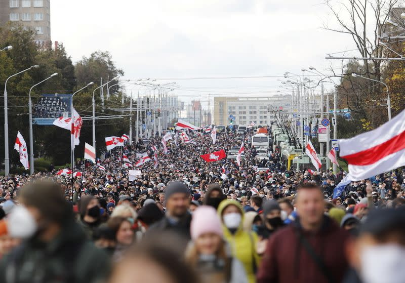 Tens of thousands march in Belarus despite firearms threat