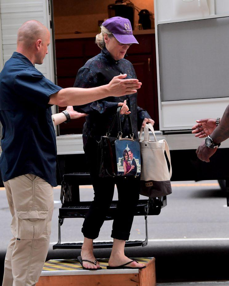 Meryl Streep carries a purse bearing the faces of former President Barack Obama and first lady Michelle Obama.