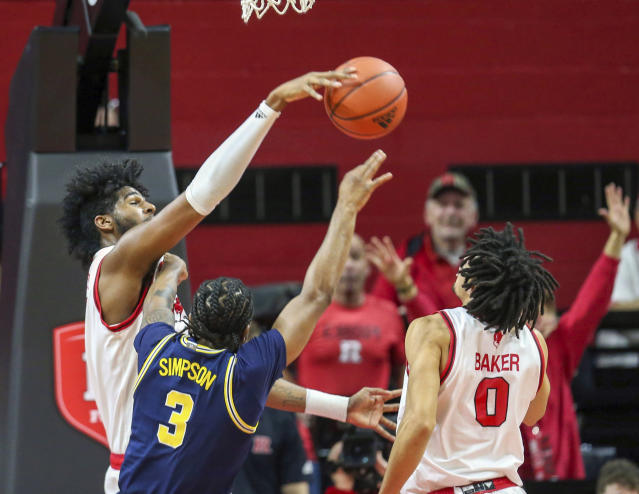 Rutgers center Myles Johnson (15) blocks a shot by Michigan guard Zavier Simpson (3) during the first half of an NCAA college basketball game, Wednesday, Feb. 19, 2020 in Piscataway, N.J. (Andrew Mills/NJ Advance Media via AP)