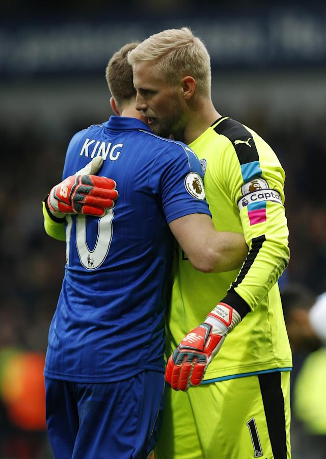 <p>Leicester City's Kasper Schmeichel celebrates after the match with Andy King </p>