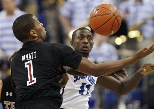 Temple's Khalif Wyatt, left, and Saint Louis' Mike McCall Jr. reach for a loose ball during the first half of an NCAA college basketball game Wednesday, Jan. 11, 2012, in St. Louis. (AP Photo/Jeff Roberson)