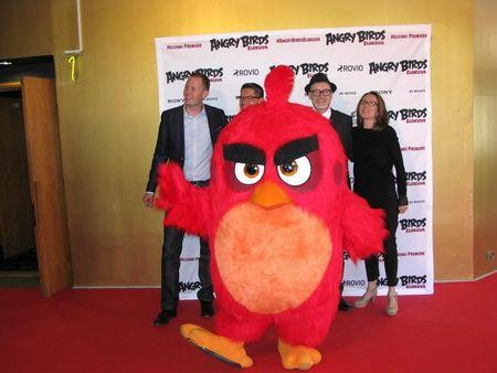 (L-R) Executive producer Mikael Hed, directors Clay Katis and Fergal Reilly and producer Catherine Winder stand with Angry Bird character Red as they pose for media during the premier in Helsinki, Finland, May 11, 2016. REUTERS/Tuomas Forsell