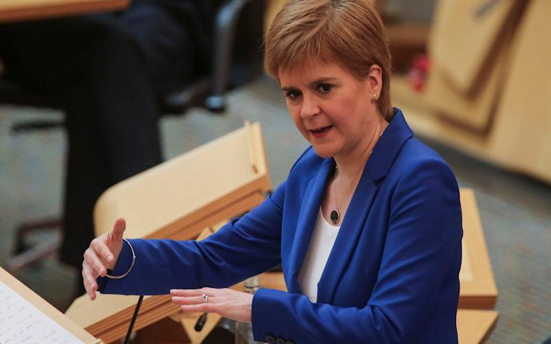 Nicola Sturgeon has come under fire over her government's guidance on transferring hospital patients into care homes - PA
