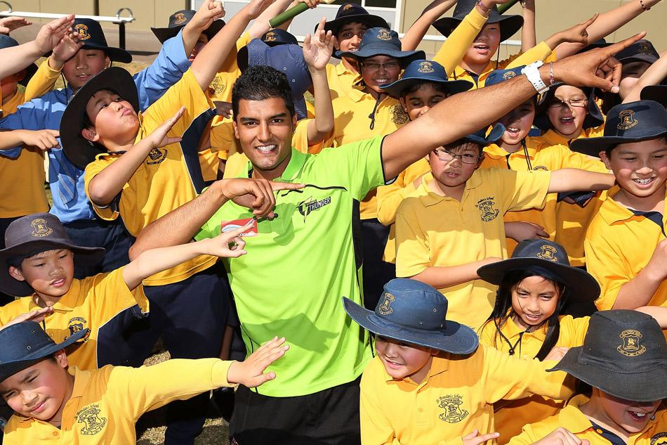 Gurinder Sandhu poses with school children during a Cricket Australia media announcement at Blacktown Sportspark on August 28, 2013 in Bankstown, Australia.  (Photo by Brendon Thorne/Getty Images)