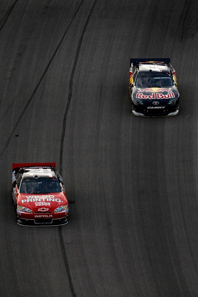 FORT WORTH, TX - NOVEMBER 06: Tony Stewart, driver of the #14 Office Depot/Mobil 1 Chevrolet, leads Kasey Kahne, driver of the #4 Red Bull Toyota, during the NASCAR Sprint Cup Series AAA Texas 500 at Texas Motor Speedway on November 6, 2011 in Fort Worth, Texas. (Photo by Tom Pennington/Getty Images for NASCAR)