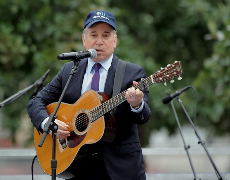 """Paul Simon performs """"Sounds of Silence"""" during the 10th anniversary commemorating the victims of the 9/11 attacks at the World Trade Center in New York"""