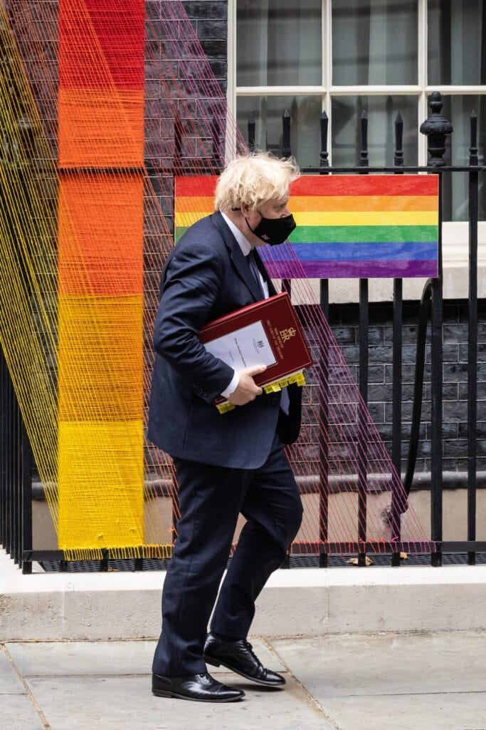LONDON, ENGLAND – JUNE 30: Britain's Prime Minister Boris Johnson walks beneath the Pride Month installation outside number 10, as he heads to the weekly PMQ session in the House of Commons, at Downing Street on June 30, 2021 in London, England. (Photo by Leon Neal/Getty Images)