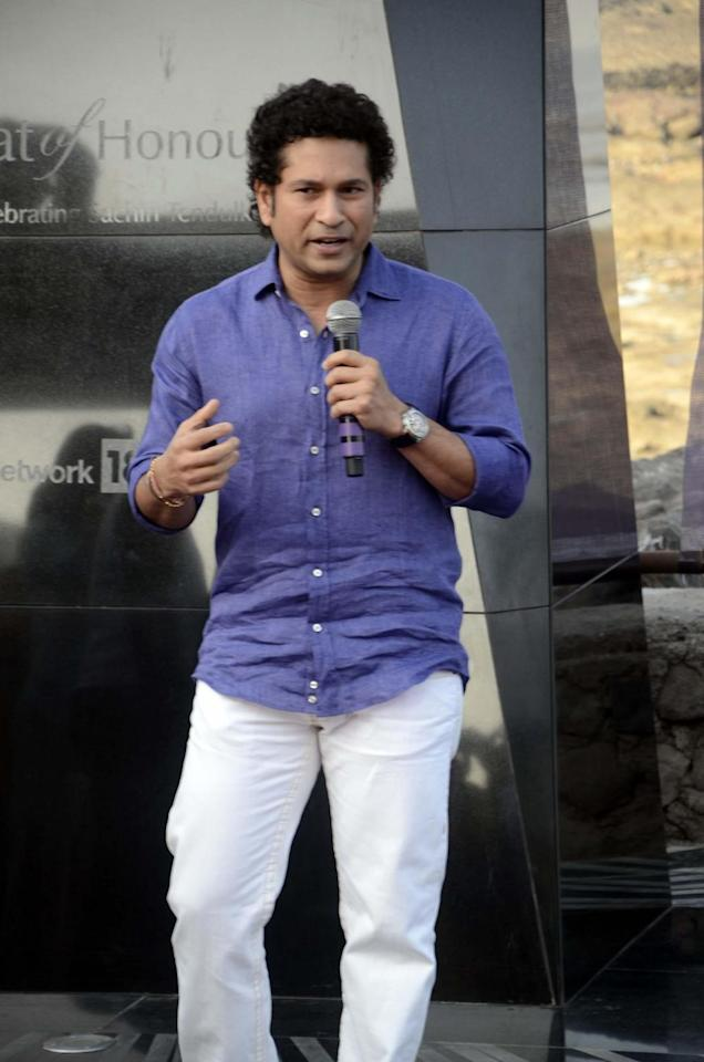 Cricket legend Sachin Tendulkar addresses during a programme to unveil `Bat of Honour` a monument in the form of a large steel bat in Mumbai on Mar.2, 2014..`Bat of Honour`, installed on the Carter Road Promenade - close to Tendulkar's residence is the largest steel bat in the world - standing more than 25 feet high and weighing over two tonnes. Sachin's emotional farewell speech has also been etched on a plaque below the installation. The monument is tribute to the cricket legend by a media group. (Photo: Sandeep Mahankal/IANS)