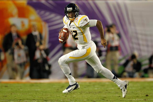 MIAMI GARDENS, FL - JANUARY 04: Geno Smith #12 of the West Virginia Mountaineers rolls out of the pocket in the first half against the Clemson Tigers during the Discover Orange Bowl at Sun Life Stadium on January 4, 2012 in Miami Gardens, Florida. (Photo by Streeter Lecka/Getty Images)