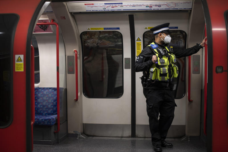 A British Transport Police officer wears a face mask on the London Underground Central line during what would normally be the evening rush hour, as the UK continues in lockdown to help curb the spread of the coronavirus.