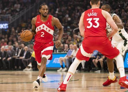 May 23, 2019; Milwaukee, WI, USA; Toronto Raptors forward Kawhi Leonard (2) dribbles the ball during the first quarter against the Toronto Raptors in game five of the Eastern conference finals of the 2019 NBA Playoffs at Fiserv Forum. Mandatory Credit: Jeff Hanisch-USA TODAY Sports