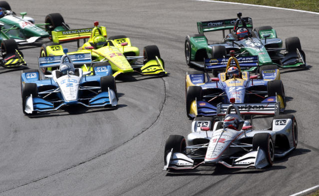 Will Power (12) leads Alexander Rossi (27) and Josef Newgarden (2) at the start of an IndyCar Series auto race, Sunday, July 28, 2019, at Mid-Ohio Sports Car Course in Lexington, Ohio. (AP Photo/Tom E. Puskar)