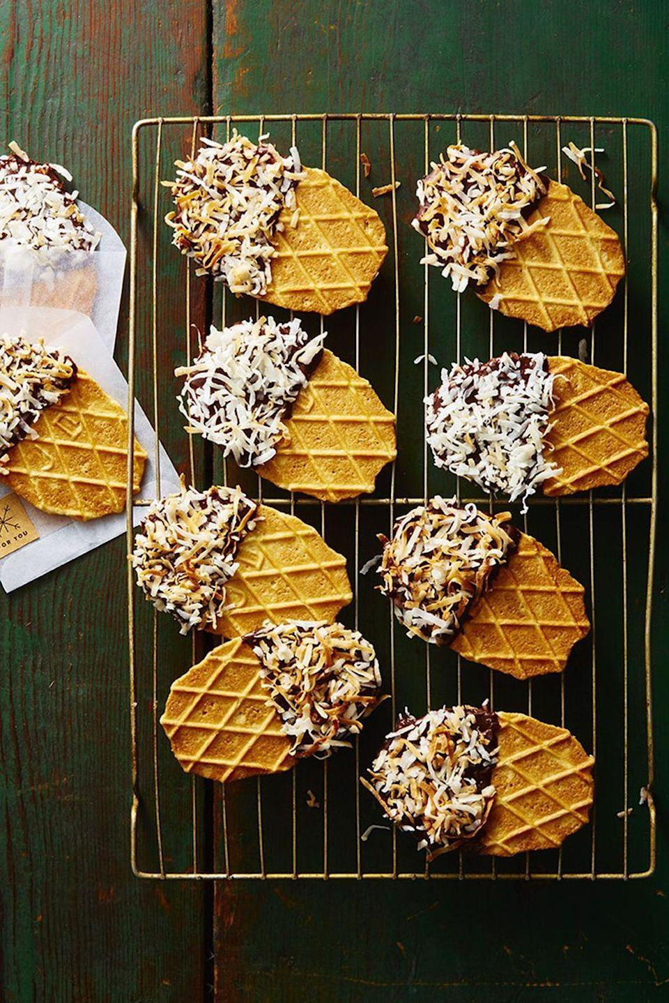 """<p>Dip store-bought waffle cookies in melted chocolate, then top with shredded coconut. You're welcome. </p><p><em><a href=""""https://www.goodhousekeeping.com/food-recipes/dessert/a46922/no-bake-waffle-dippers-recipe/"""" rel=""""nofollow noopener"""" target=""""_blank"""" data-ylk=""""slk:Get the recipe for Waffle Dippers »"""" class=""""link rapid-noclick-resp"""">Get the recipe for Waffle Dippers »</a></em><br></p>"""