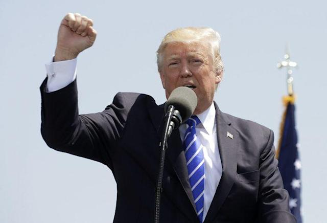 President Trump pumps his fist as he addresses the graduating class of the U.S. Coast Guard Academy during commencement ceremonies in New London, Conn., on May 17, 2017. (Photo: Kevin Lamarque/Reuters)