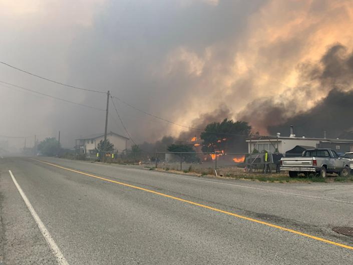Smoke rises above the small western Canadian town of Lytton after wildfires forced its residents to evacuate, in Lytton, British Columbia, Canada 30, 2021.  (via REUTERS)