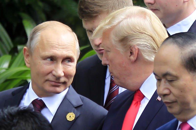 """Russian President Vladimir Putin, left, and U.S. President Donald Trump talk as they arrive for the family photo session during the Asia-Pacific Economic Cooperation (APEC) Summit in Danang, Vietnam, Saturday, Nov. 11, 2017. President Trump stood before a summit of Asian leaders keen on regional trade pacts and delivered a roaring """"America first"""" message Friday, denouncing China for unfair trade practices just a day after he had heaped praise on President Xi Jinping in Beijing. (AP Photo/Hau Dinh)"""
