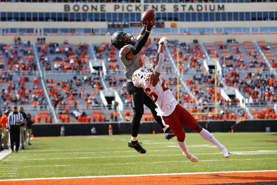 STILLWATER, OK - OCTOBER 24:  Wide receiver Tylan Wallace #2 of the Oklahoma State Cowboys fails to make a pass reception in the end zone against defensive back Anthony Johnson Jr. #26 of the Iowa State Cyclones in the first quarter at Boone Pickens Stadium on October 24, 2020 in Stillwater, Oklahoma.  (Photo by Brian Bahr/Getty Images)