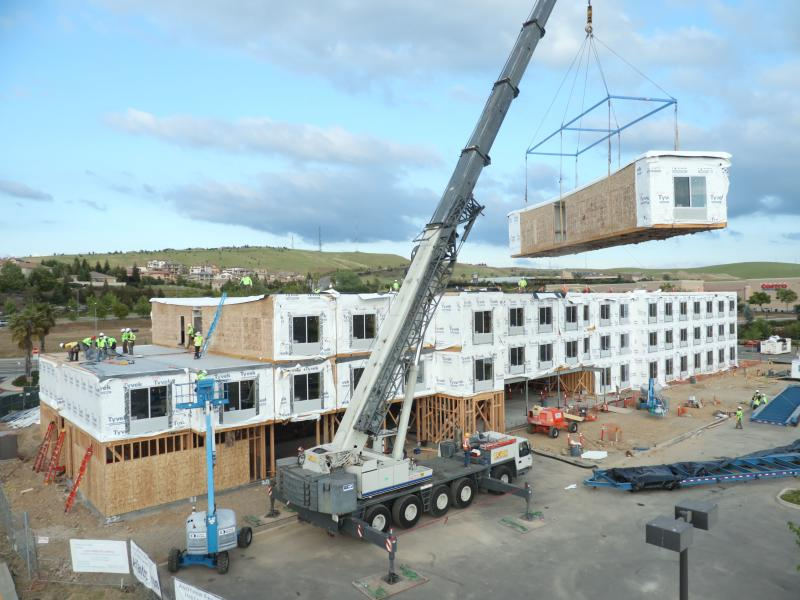 Built section-by-section in a factory, hotel units are shipped to a site and stacked, sometimes practically overnight. Photo credit: Guerdon Modular Buildings.