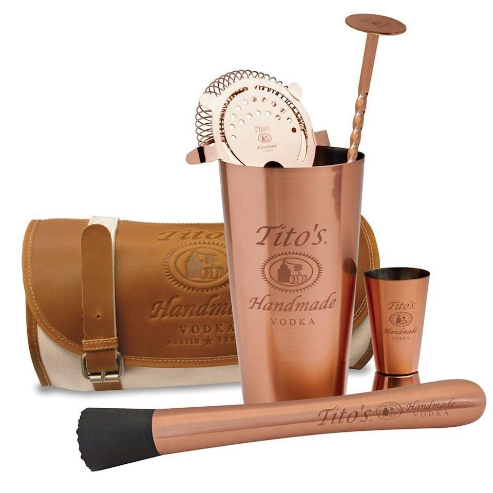 """<p><strong>Tito's</strong></p><p>Tito's</p><p><strong>$75.00</strong></p><p><a href=""""https://store.titosvodka.com/collections/barware/products/mixology-kit"""" rel=""""nofollow noopener"""" target=""""_blank"""" data-ylk=""""slk:BUY NOW"""" class=""""link rapid-noclick-resp"""">BUY NOW</a></p><p>Consider yourself to be a huge Tito's fan? Then this mixology kit is just for you. You'll get a muddler, 28-ounce Boston shaker, strainer, jigger, bar spoon, and a canvas and leather satchel to carry it all in. Not to mention it's very appealing to the eye.</p>"""