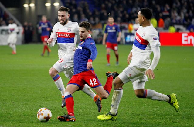Soccer Football - Europa League Round of 16 Second Leg - Olympique Lyonnais vs CSKA Moscow - Groupama Stadium, Lyon, France - March 15, 2018 CSKA Moscow's Georgi Shchennikov in action with Lyon's Lucas Tousart REUTERS/Emmanuel Foudrot