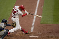 St. Louis Cardinals' Nolan Arenado hits a two-run home run during the eighth inning of a baseball game against the Milwaukee Brewers Thursday, April 8, 2021, in St. Louis. (AP Photo/Jeff Roberson)