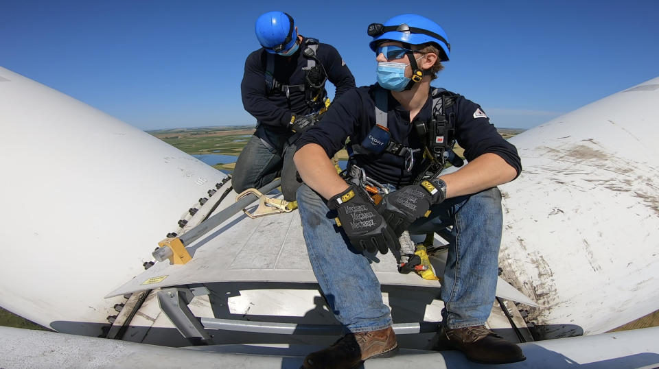 Don Williams and a colleague at work atop a wind turbine in North Dakota. / Credit: CBS News