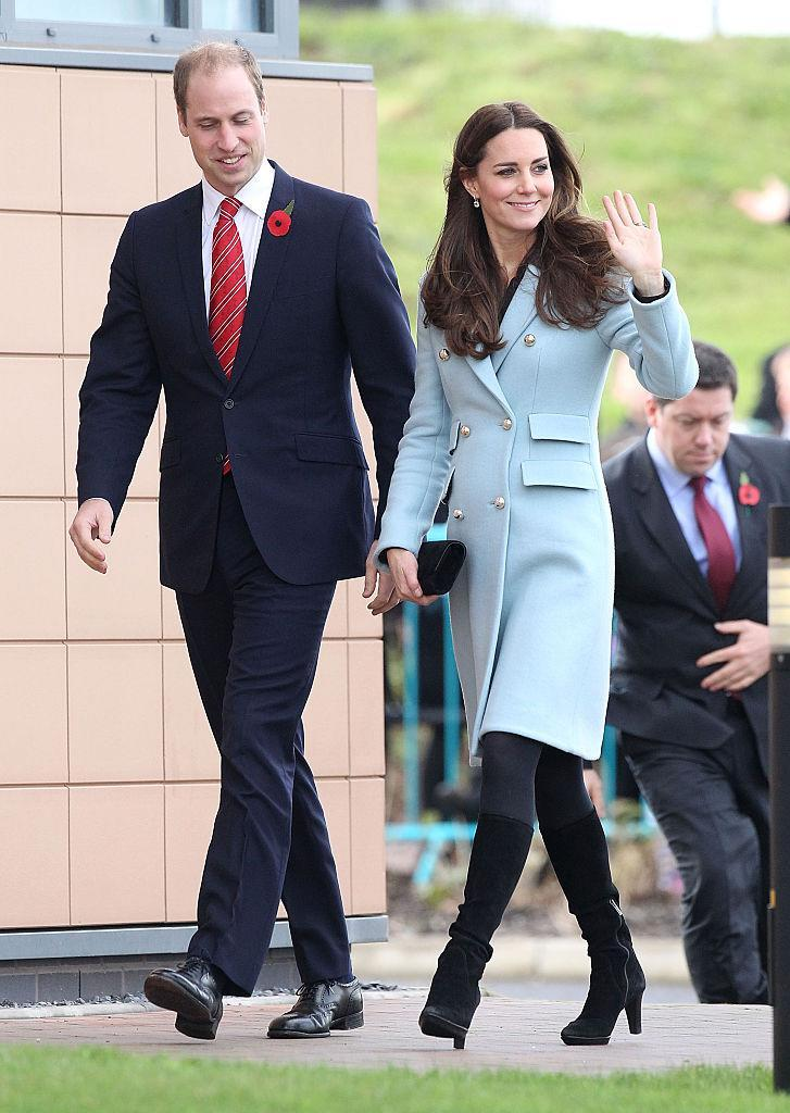 <p>On November 8, the Duke and Duchess of Cambridge visited Pembroke, Wales. Kate dressed her bump in a powder blue military-inspired coat by Mathew Williamson and finished the look with knee-high boots and a black clutch. <em>[Photo: Getty]</em> </p>