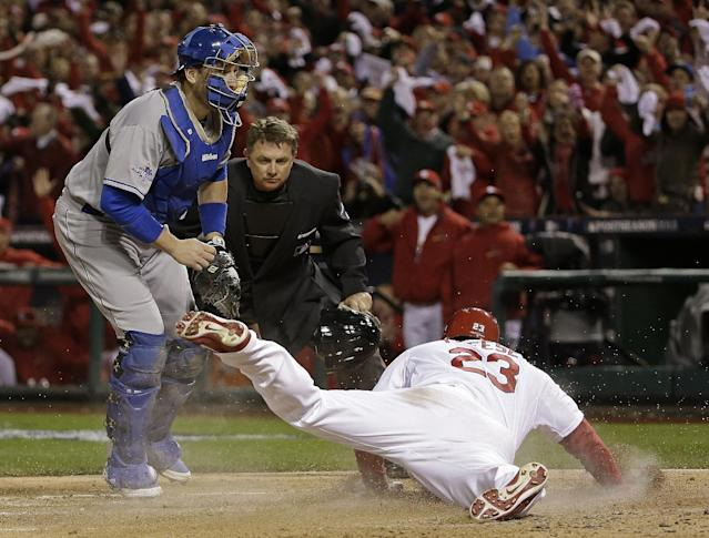 St. Louis Cardinals' David Freese scores in front of Los Angeles Dodgers catcher A.J. Ellis during the third inning of Game 6 of the National League baseball championship series, Friday, Oct. 18, 2013, in St. Louis. (AP Photo/David J. Phillip)