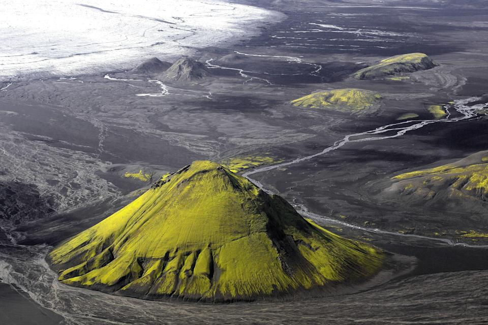 A volcanic cone of ashes and lava rock, the 2595-foot Mælifell sits on the edge of the Mýrdalsjökull glacier and covered in grimmia, a moss that changes color depending on the soil's humidity. You can drive past the volcano during the summer months, or see it along the Laugavegur Route: the most popular multi-day hiking route in Iceland.