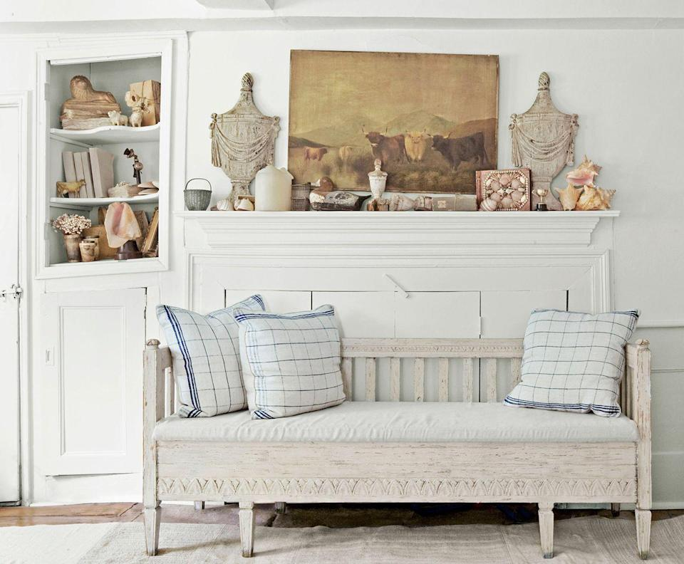 <p>A pair of patterned pillows bring comfort to this neutral living room that's perfect for reading. </p>
