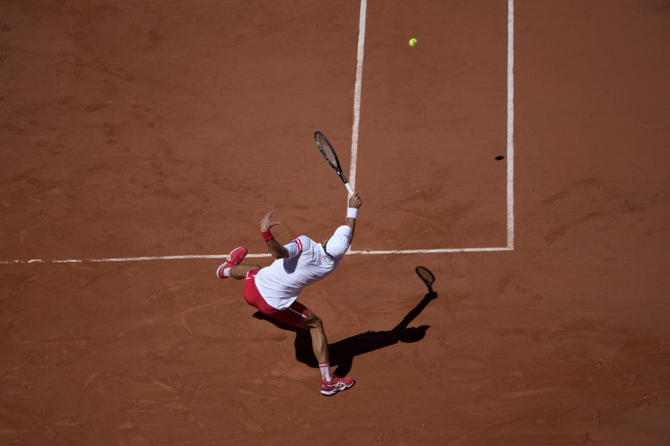 Serbia's Novak Djokovic returns the ball to Stefanos Tsitsipas of Greece during their final match of the French Open tennis tournament at the Roland Garros stadium Sunday, June 13, 2021 in Paris. (AP Photo/Christophe Ena)