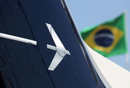 The logo of Brazilian aviation company Embraer is seen during the Latin American Business Aviation Conference & Exhibition fair (LABACE) at Congonhas Airport in Sao Paulo, Brazil August 14, 2018. REUTERS/Paulo Whitaker