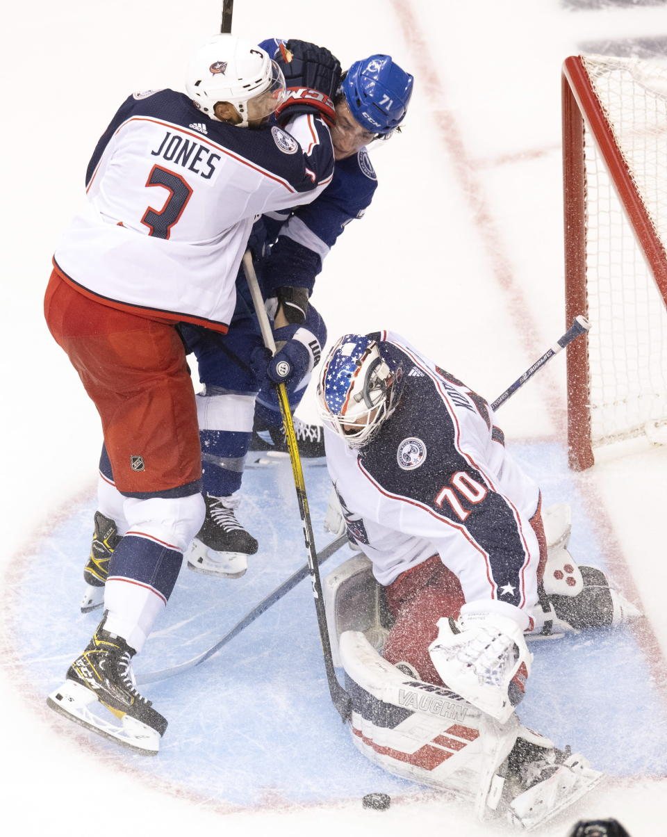 Columbus Blue Jackets defenceman Seth Jones (3) picks up a holding call as Tampa Bay Lightning center Anthony Cirelli (71) makes a short-handed breakaway attempt on Jackets goaltender Joonas Korpisalo (70) during the second period of an NHL Eastern Conference Stanley Cup first-round playoff hockey game in Toronto on Tuesday, August 11, 2020. (Frank Gunn/The Canadian Press via AP)