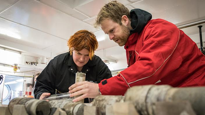 Johann Klages (R) inspects the sediment cores on RV Polarstern