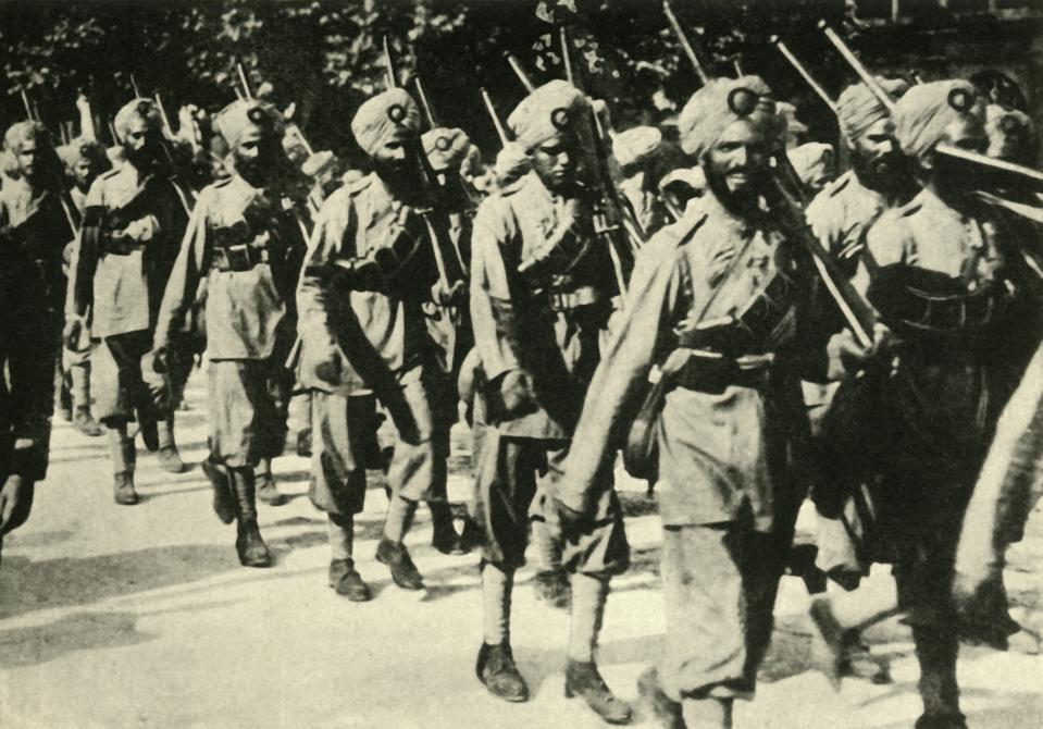 """Indian soldiers in France, First World War, 1914, (circa 1920). A Sikh regiment on the march. Over one million Indian troops in the British Indian Army (of the Raj) fought in the European, Mediterranean and the Middle East theatres of war. At least 74,187 Indian soldiers died, with 67,000 wounded. From """"The Great World War - A History"""" Volume I, edited by Frank A Mumby. [The Gresham Publishing Company Ltd, London, circa 1920]. Artist Unknown. (Photo by The Print Collector via Getty Images)"""