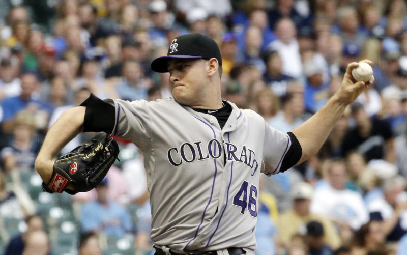 Colorado Rockies starting pitcher Tyler Matzek throws during the first inning of a baseball game against the Milwaukee Brewers on Friday, June 27, 2014, in Milwaukee. (AP Photo/Morry Gash)