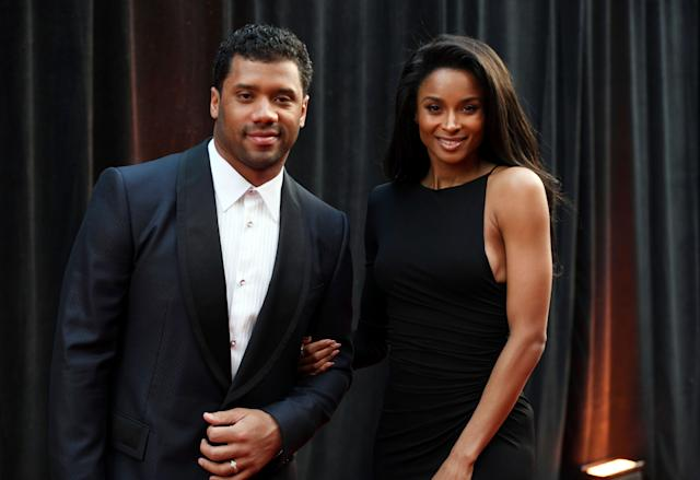 Russell Wilson, shown with wife Ciara, gave the Seattle Seahawks an April 15 deadline for a contract extension. (AP)