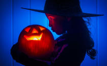 <p>A young girl with a pumpkin as she prepares for Halloween. (PA) </p>
