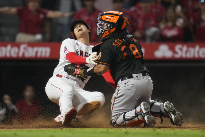 Los Angeles Angels designated hitter Shohei Ohtani (17) slides in to home to score ahead of a tag by Baltimore Orioles catcher Pedro Severino (28) during the ninth inning of a baseball game Friday, July 2, 2021, in Anaheim, Calif. The run won the game for the Angels 8-7. (AP Photo/Ashley Landis)