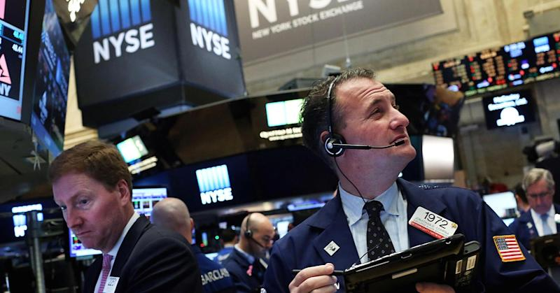 Dow jumps 100 points to record as Street shakes off weak jobs report